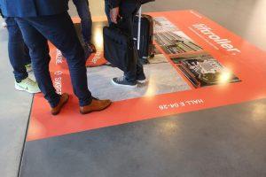 Liftroller reklame på gulvet på Bygg Reis Deg messen 2019
